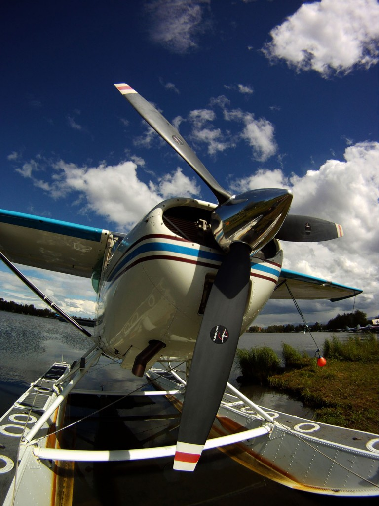 low angle shot of a Cessna 185 at Lake Hood Alaska