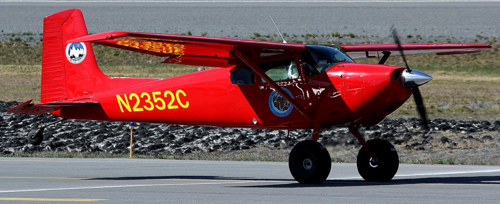 Red Cessna 180 on a take off roll - Portrait Photographer & Alaska Photography l Alaskafoto - Alaska Air Cargo