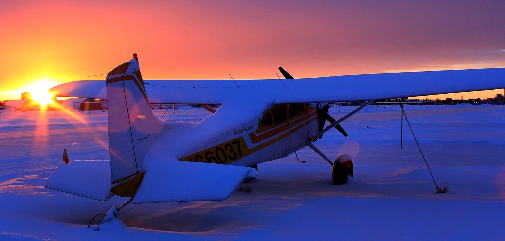 Sunset behind a Cessna 185 - Alaska Air Cargo & environmental portrait l Alaskafoto - portrait photographer
