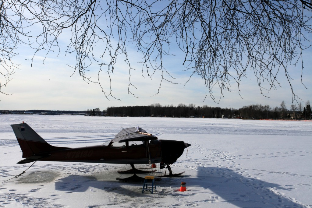 Plane on skis on a frozen lake- Portrait Photographer & Best Aircraft Photography l Alaskafoto - Alaska Air Cargo