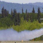 Christen Eagle take off with smoke. Photo by Rob Stapleton/Alaskafoto