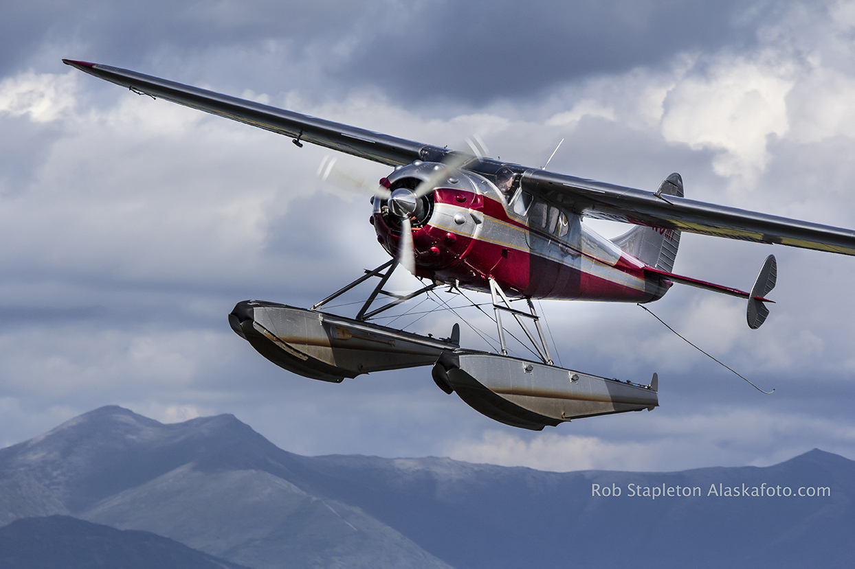 A Cessna on floats air to air type photo